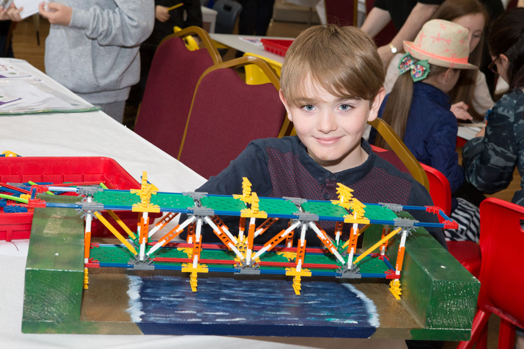 Rochester Bridge Trust hosts a free family Bridge Building Day at The Guildhall Museum, Rochester. Pictured is Ethan MacKenzie (aged 11) with a Truss Bridge build with Knex. The Guildhall Musuem, High Street, Rochester, Kent. ME1 1PY.